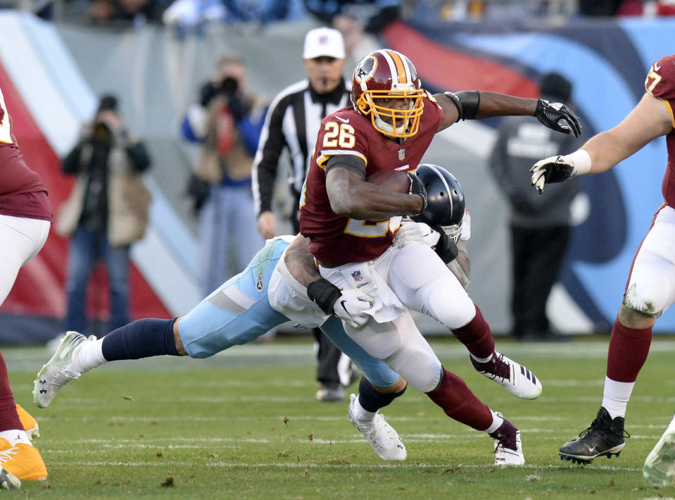 Adrian Peterson hit the 1,000-yard mark on Saturday, becoming the oldest running back to do so since 1984. (AP Photo/Mark Zaleski)
