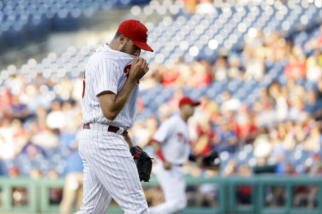 Philadelphia Phillies starting pitcher Zach Eflin wipes his face after the first inning of a baseball game against the Toronto Blue Jays, Friday, May 25, 2018, in Philadelphia. (AP Photo/Matt Slocum)