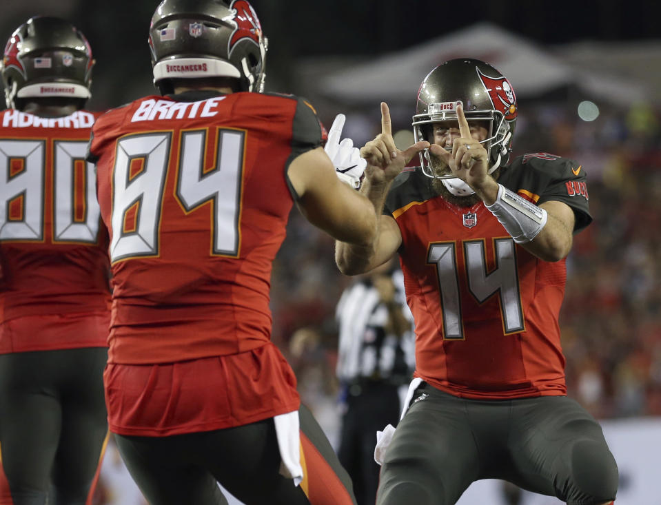 Ryan Fitzpatrick celebrates a touchdown during Monday night's game against the Steelers. (AP)