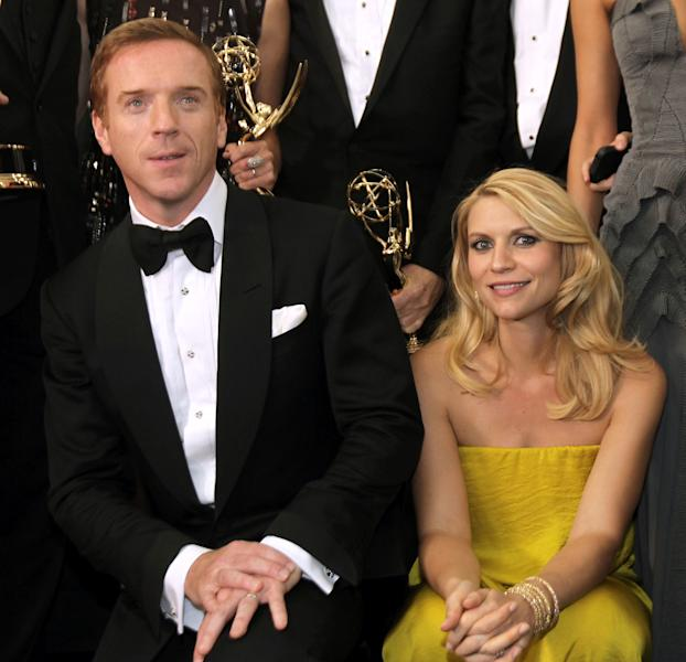 "Actor Damien Lewis, left, winner of the Emmy for outstanding lead actor in a drama series for ""Homeland"" and actress Claire Danes, winner of the Emmy for outstanding lead actress in a drama series, also for ""Homeland"", pose backstage at the 64th Primetime Emmy Awards at the Nokia Theatre on Sunday, Sept. 23, 2012, in Los Angeles. (Photo by Matt Sayles/Invision/AP)"