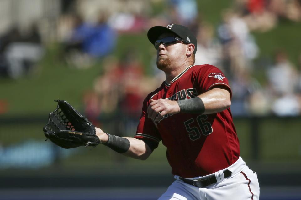 Arizona Diamondbacks right fielder Kole Calhoun runs in to make a catch on a fly ball hit by Kansas City Royals' Ryan McBroom during the first inning of a spring training baseball game Monday, March 9, 2020, in Scottsdale, Ariz. (AP Photo/Ross D. Franklin)