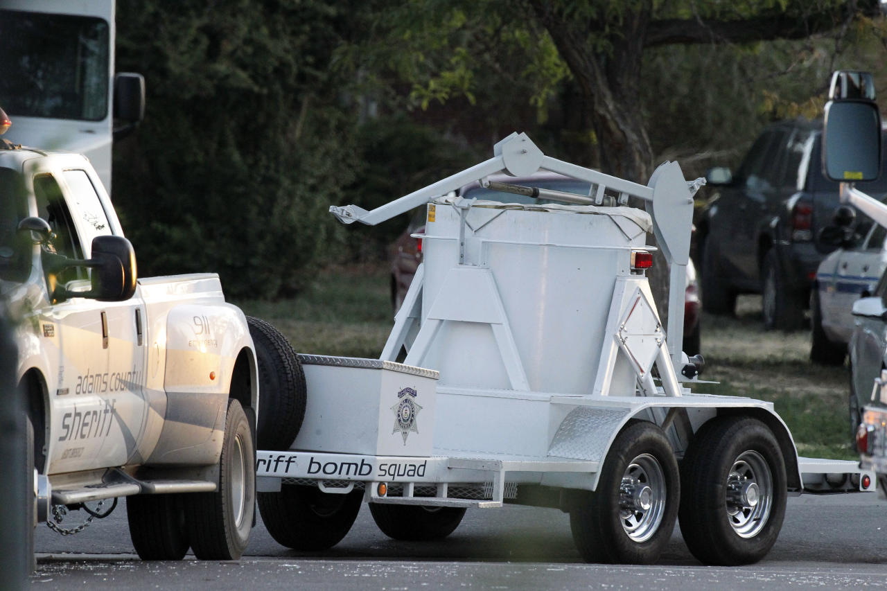 "A bomb disposal vehicle arrives near the apartment of alleged gunman James Holmes Saturday, July 21, 2012 in Aurora , Colo. Authorities reported that 12 died and more than three dozen people were shot during an assault at a movie theatre midnight premiere of ""The Dark Knight Rises"" early Friday. (AP Photo/Alex Brandon)"