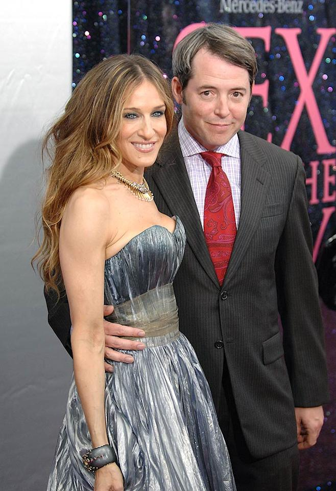 "Sarah Jessica Parker, with hubby Matthew Broderick, said she selected her silver dress because it reminded her of NYC architecture. Fortunately, she opted not to wear a goofy hat like she did at the movie's London premiere! Dimitrios Kambouris/<a href=""http://www.wireimage.com"" target=""new"">WireImage.com</a> - May 27, 2008"