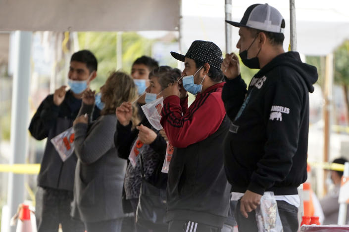 People take a COVID-19 test on the Martin Luther King Jr. Medical Campus, Thursday, Jan. 7, 2021, in Los Angeles. (AP Photo/Marcio Jose Sanchez)