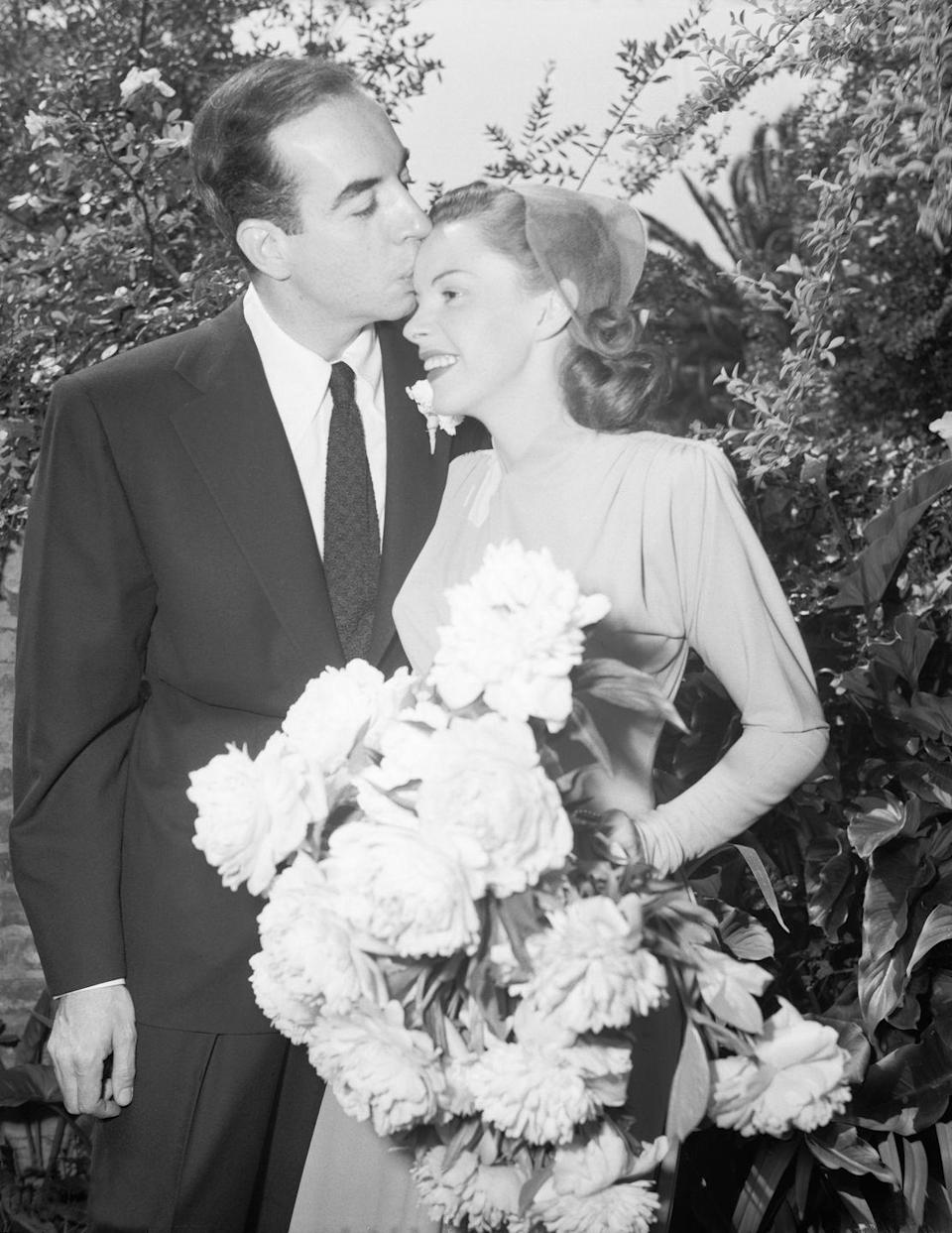 """<p>Judy Garland's bouquet of white peonies nearly filled the entire camera frame as she and Vincente Minnelli said """"I do"""" in the backyard of Garland's mother's home in Hollywood. </p><p><strong>More:</strong> <a href=""""https://www.townandcountrymag.com/leisure/arts-and-culture/a30284220/judy-garland-husbands/"""" rel=""""nofollow noopener"""" target=""""_blank"""" data-ylk=""""slk:Who Were Judy Garland's Five Husbands?"""" class=""""link rapid-noclick-resp"""">Who Were Judy Garland's Five Husbands?</a></p>"""