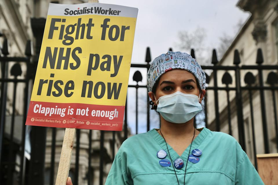 LONDON, UNITED KINGDOM - MARCH 7: NHS nurses gather outside 10 Downing street to protest the government's decision to recommend a 1% pay rise in London, United Kingdom on March 7, 2021. (Photo by Hasan Esen/Anadolu Agency via Getty Images)