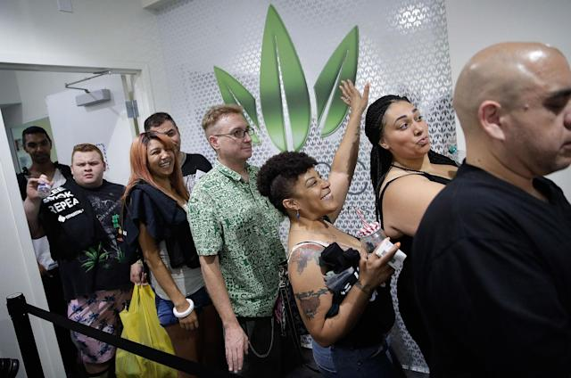 <p>People wait in line at the Essence cannabis dispensary, Saturday, July 1, 2017, in Las Vegas. Nevada dispensaries were legally allowed to sell recreational marijuana starting at 12:01 a.m. Saturday. (Photo: John Locher/AP) </p>