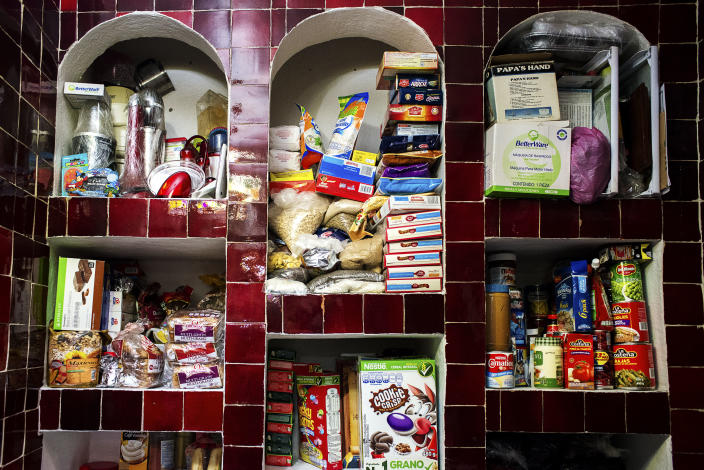 <p>The pantry of Antonia Casilla Guzman, 62. Guzman suffers from obesity and one of her daughters, has had a gastric bypass operation to lose weight. (Photograph by Silvia Landi) </p>