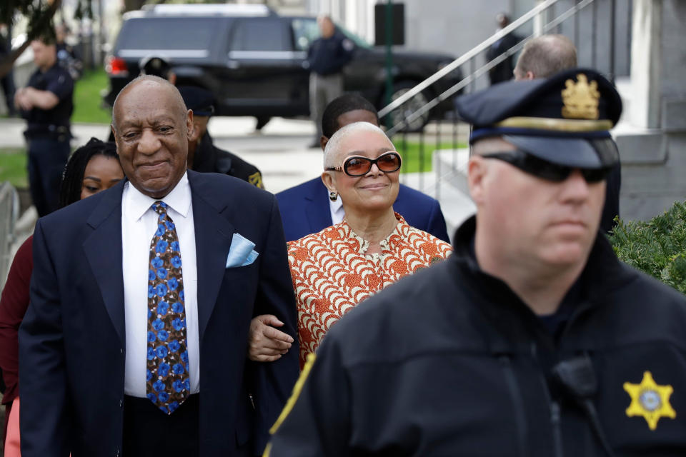 FILE - In this April 24, 2018, file photo, Bill Cosby, left, arrives with his wife, Camille, for his sexual assault trial, at the Montgomery County Courthouse in Norristown, Pa. Pennsylvania's highest court has overturned Cosby's sex assault conviction. The court said Wednesday, June 30, 2021, that they found an agreement with a previous prosecutor prevented him from being charged in the case. (AP Photo/Matt Slocum, File)