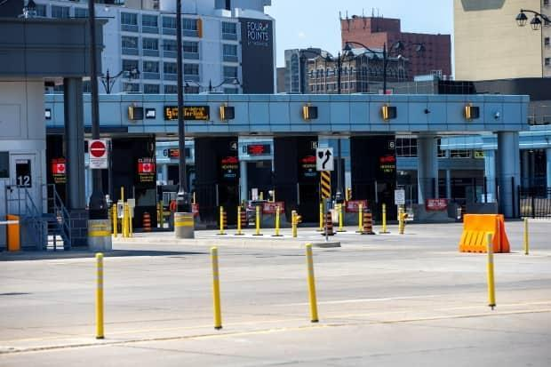 The Windsor-Detroit tunnel links Canada and the United States, but won't host a cross-border vaccination clinic. The Canada Border Services Agency has rejected the proposal.  (Carlos Osorio/Reuters - image credit)