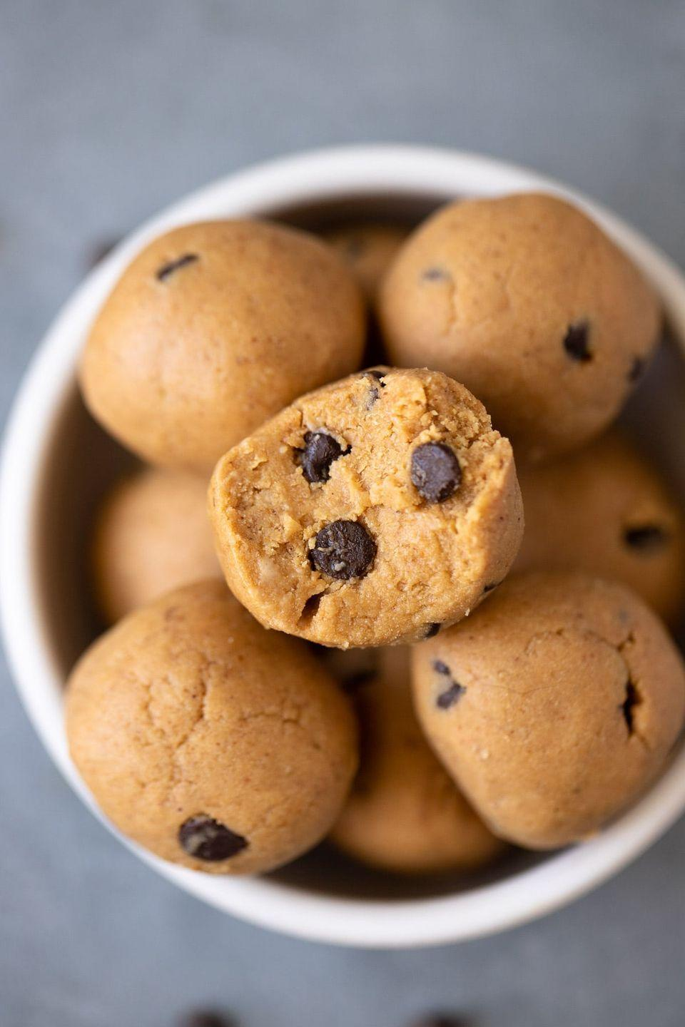 """<p>This dish reminds me of my childhood days when I'd sneak a taste of cookie dough from my mother while helping her bake. Now with this recipe, I can enjoy my cookie dough without the risks of eating uncooked eggs. </p><p>For an added energy boost, this recipe adds in protein powder— but before throwing yours in, just make sure it's vegan. </p><p><a class=""""link rapid-noclick-resp"""" href=""""https://thecleaneatingcouple.com/no-bake-protein-balls/#recipe"""" rel=""""nofollow noopener"""" target=""""_blank"""" data-ylk=""""slk:Get the recipe"""">Get the recipe </a></p><p><em>Per one serving: 72 cal, 4 g fat, (1 g saturated fat), 5 g carbs, 3 g sugar, 42 mg sodium, 1 g fiber, 4 g protein</em></p>"""