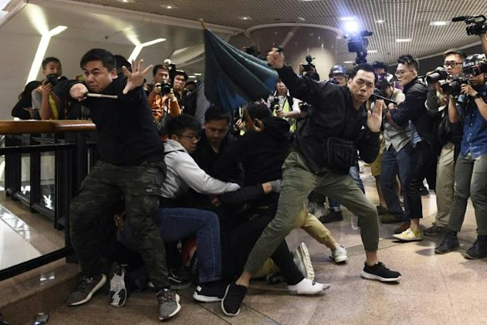 Riot police used pepper spray and batons to beat back angry crowds after plainclothes officers made arrests inside Hong Kong's Harbour City, a luxury mall (AFP Photo/Philip FONG)