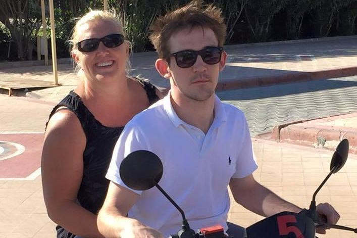 Stab victim: Jonathan McPhillips, pictured with his mother Michelle