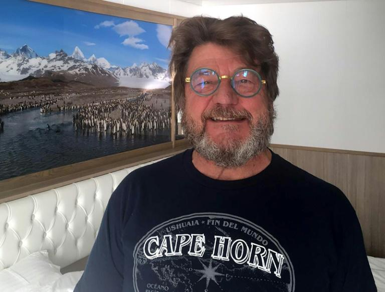 "Charley Nadin, 67, posing onboard the Australian cruise ship Greg Mortimer off the port of Montevideo, praised the ""extraordinary"" care from local health authorities (AFP Photo/Maurice John CLIFFORD)"