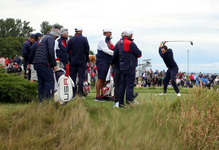 Curtain up: Fans look on as American Patrick Cantlay plays a practice round before the 43rd Ryder Cup at Whistling Straits (AFP/Stacy Revere)