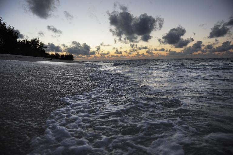 File photo of the waters of the Indian Ocean lapping on the shores of the low lying coraline island of Denis in the outer banks or the Seychelles islands