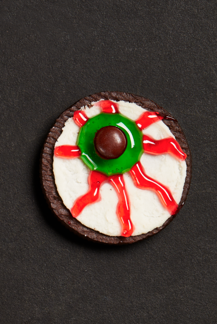 """<p>If you don't have too much time to bake but you want a dessert that's as spooky as the rest of the Halloween party you've organized, then these are the dessert for you. Just twist open your favorite store-bought sandwich cookie and quickly decorate! </p><p><strong><em>Get the recipe at <a href=""""https://www.thepioneerwoman.com/food-cooking/recipes/a32129658/sandwich-cookie-eyeballs-recipe/"""" rel=""""nofollow noopener"""" target=""""_blank"""" data-ylk=""""slk:The Pioneer Woman"""" class=""""link rapid-noclick-resp"""">The Pioneer Woman</a>.</em></strong></p>"""