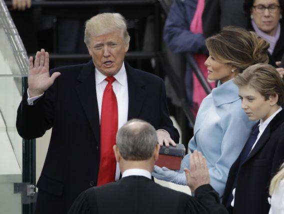 Donald Trump is sworn in as the 45th president of the United States by Chief Justice John Roberts as Melania Trump looks on during the 58th Presidential Inauguration at the U.S. Capitol in Washington, D.C., Friday, Jan. 20, 2017.