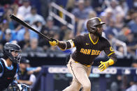San Diego Padres' Jurickson Profar watches his RBI single during the fourth inning of the team'sp baseball game against the Miami Marlins, Thursday, July 22, 2021, in Miami. (AP Photo/Lynne Sladky)