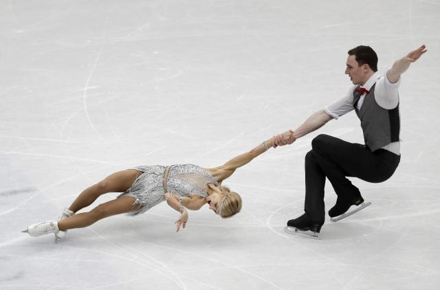Germany's skaters Aljona Savchenko and Bruno Massot perform during a pairs short program at the Figure Skating World Championships in Assago, near Milan, Wednesday, March 21, 2018. (AP Photo/Luca Bruno)