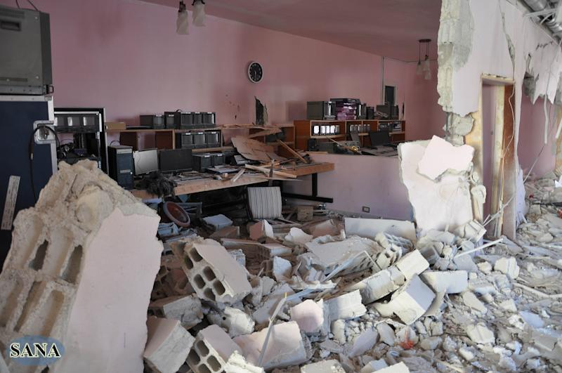 "In this photo released by the Syrian official news agency, SANA, the damaged control room of Ikhbariya TV station is seen after it was attacked by gunmen in the town of Drousha, about 20 kilometers (14 miles) south of Damascus, Syria, Wednesday, June 27, 2012. Gunmen raided the headquarters of a pro-government Syrian TV station early Wednesday, demolishing the building and killing several employees, the state media reported. Syrian officials denounced what they called a rebel ""massacre against the freedom of the press."" (AP Photo/SANA)"