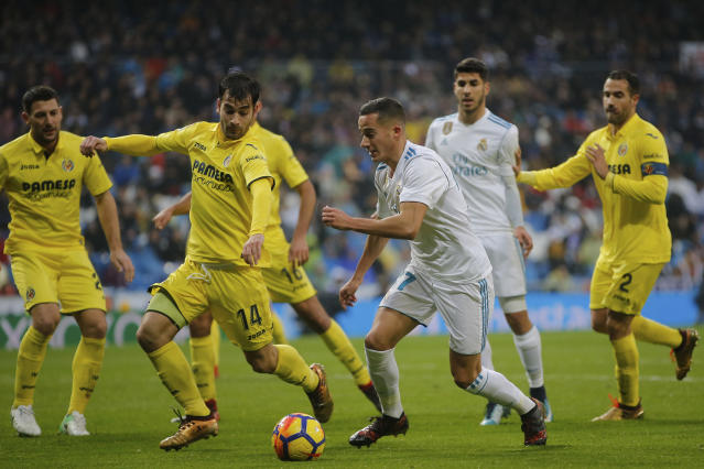 Real Madrid's Lucas Vazquez controls the ball during a Spanish La Liga soccer match between Real Madrid and Villarreal at the Santiago Bernabeu stadium in Madrid, Spain, Saturday, Jan. 13, 2018. (AP Photo/Paul White)