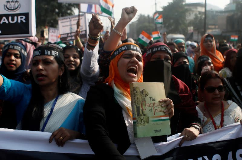 Demonstrators shout slogans during a protest against a new citizenship law on the outskirts of Mumbai