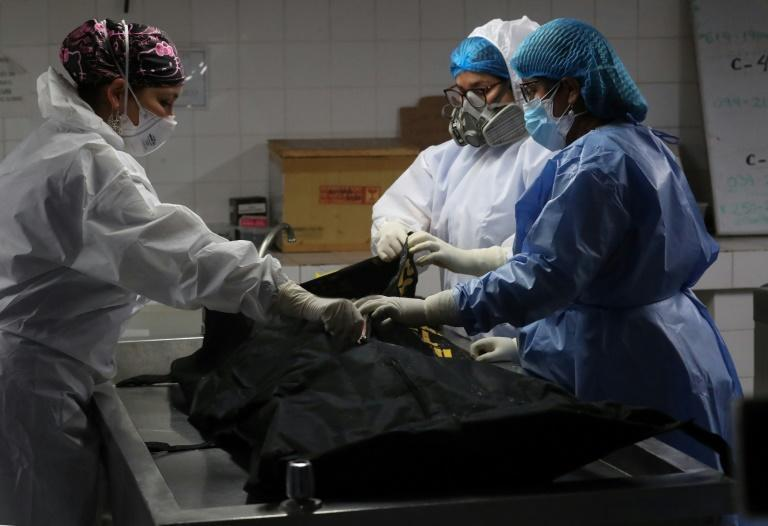 Guzman's remains at the morgue, according to this official photograph (AFP/ROLLY REYNA)