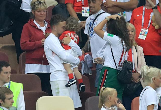 <p>Kieran Trippier embraces his daughter. </p>