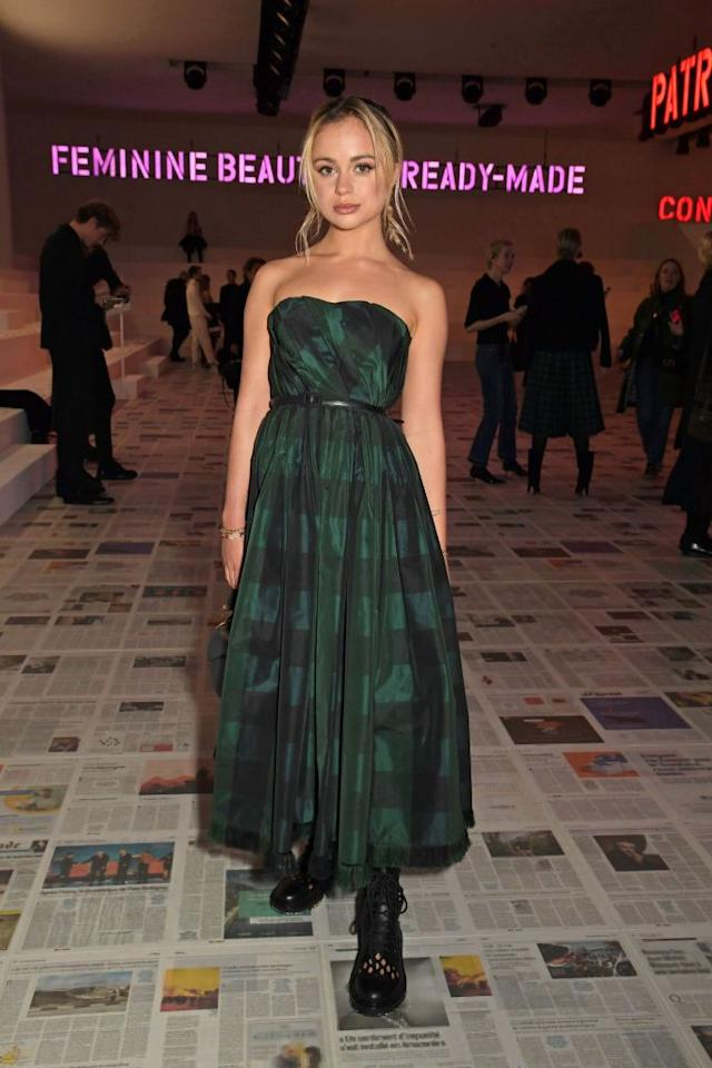 <p>Amelia Windsor dressed in a strapless checked dress and chunky boots. </p>