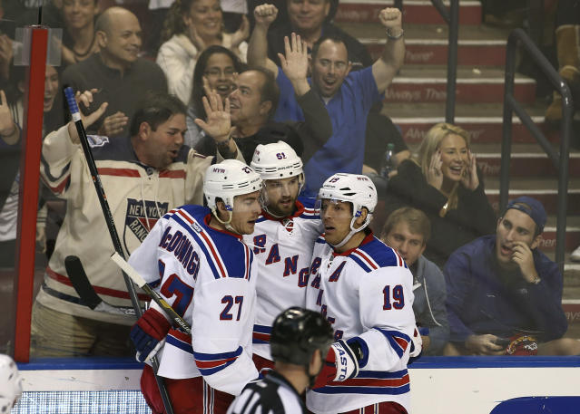 New York Rangers' Ryan McDonagh (27), Brad Richards (19) and Rick Nash (61) celebrate after Nash scored a goal against the Florida Panthers during the third period of an NHL hockey game in Sunrise, Fla., Wednesday, Nov. 27, 2013. The Rangers won 5-2. (AP Photo/J Pat Carter)