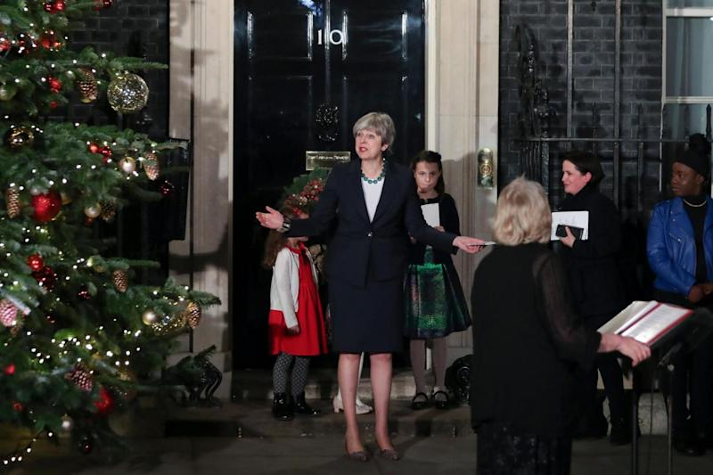 Theresa May gestures during the switch on (AFP/Getty Images)