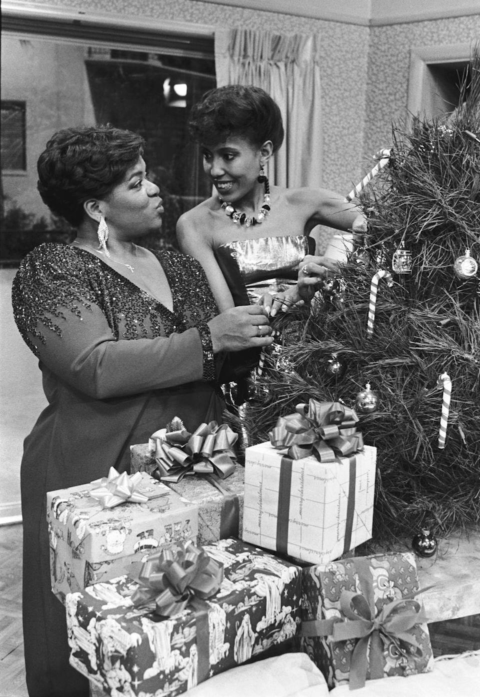 <p>The<em> Gimme a Break</em> actresses film a holiday special for Christmas. The television show saw the stars trimming a tree with candy canes in front of wrapped presents. </p>