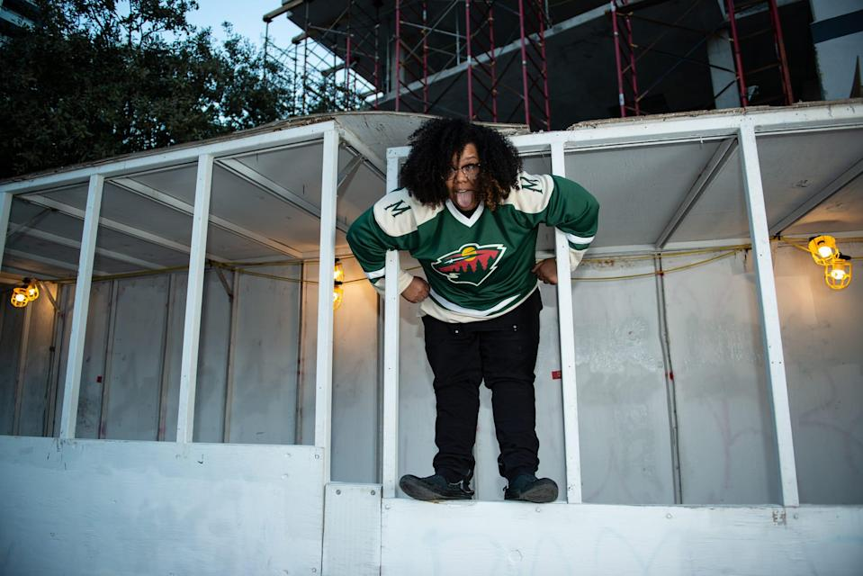 """Kori Roy, stage name Mama Duke, climbs on a pedestrian construction tunnel in Downtown Austin, Jan. 3, 2021. The 33-year-old rapper from Palacios, Texas, started rapping during lunch periods in high school. """"That's where the itch started from me,"""" she said. In December, Mama Duke released an album titled """"Ballsy."""" [Angela Piazza for Statesman]"""