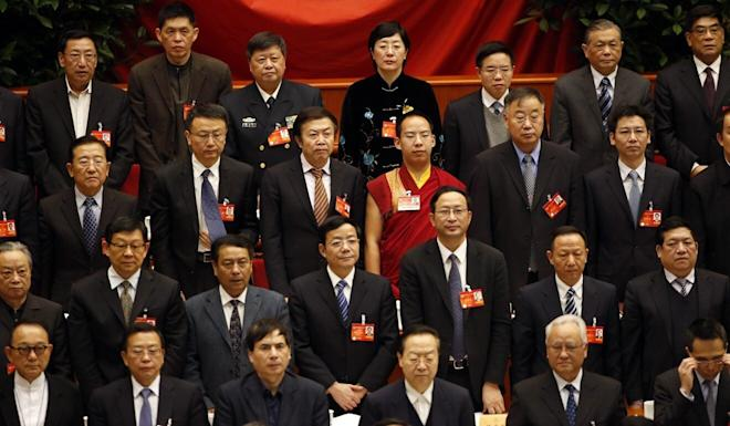 Gyaincain Norbu stands with other CPPCC delegates as they listen to the national anthem at the Great Hall of the People in Beijing in 2014. Photo: Reuters