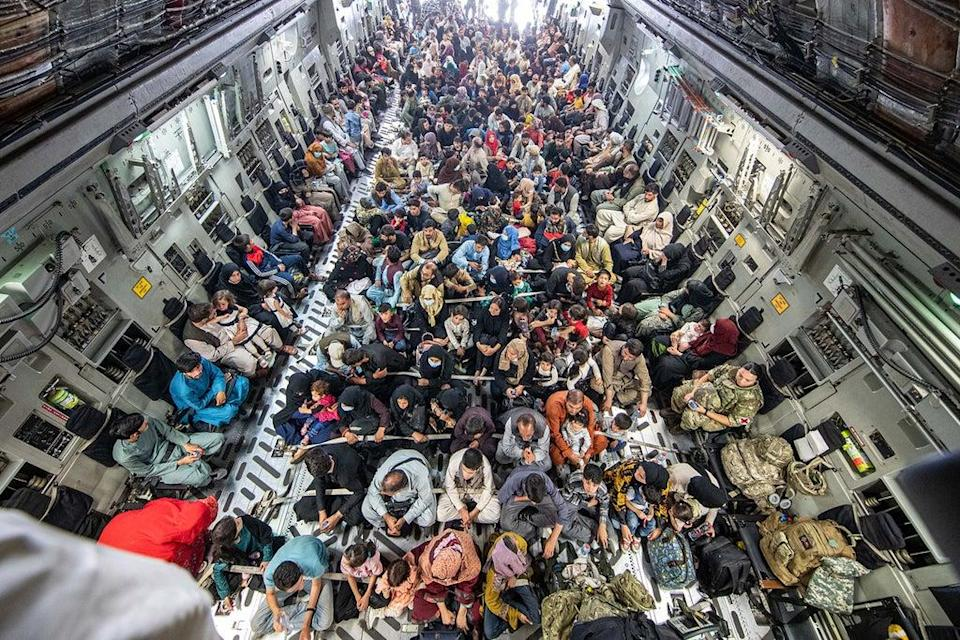 A full flight of 265 people supported by members of the UK Armed Forces on board an evacuation flight out of Kabul airport (LPhot Ben Shread/MoD) (PA Media)