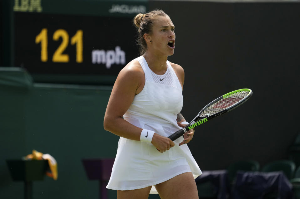 Belarus's Aryna Sabalenka celebrates winning a point against Colombia's Maria Camila Osorio Serrano during the women's singles third round match on day five of the Wimbledon Tennis Championships in London, Friday July 2, 2021. (AP Photo/Alberto Pezzali)