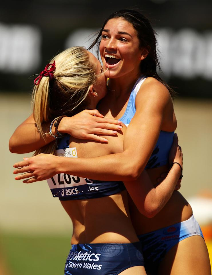 SYDNEY, AUSTRALIA - MARCH 16:  Michelle Jenneke (R) of NSW celebrates with 2nd placegetter Abble Taddeo (L) of NSW after winning the Womens U20 100m Hurdles Final during day three of the Australian Junior Athletics Championships at Sydney Olympic Park Athletic Centre on March 16, 2012 in Sydney, Australia.  (Photo by Matt King/Getty Images)