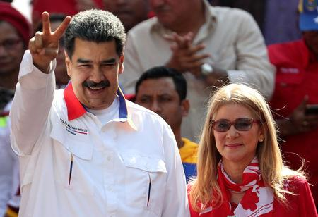 Venezuela's President Nicolas Maduro greets people next to his wife Cilia Flores during a rally in support of the government in Caracas, Venezuela May 20, 2019. REUTERS/Ivan Alvarado
