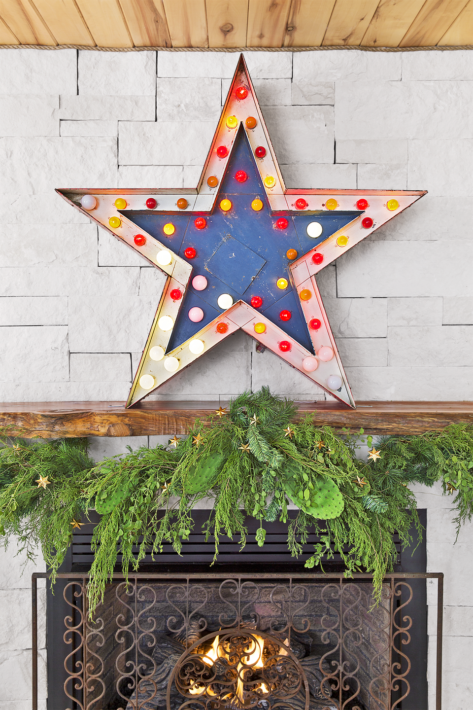 """<p>When paired with fresh garland, a vintage star light makes a statement on the mantel of the Junk Gypsies' <a href=""""https://www.countryliving.com/home-design/house-tours/g4931/junk-gypsies-texas-inn/"""" rel=""""nofollow noopener"""" target=""""_blank"""" data-ylk=""""slk:inn in Round Top, Texas"""" class=""""link rapid-noclick-resp"""">inn in Round Top, Texas</a>.</p><p><a class=""""link rapid-noclick-resp"""" href=""""https://go.redirectingat.com?id=74968X1596630&url=https%3A%2F%2Fwww.wayfair.com%2Fkeyword.php%3Fkeyword%3Dstar%2Bmarquee%2Blight&sref=https%3A%2F%2Fwww.countryliving.com%2Fhome-design%2Fdecorating-ideas%2Fadvice%2Fg1247%2Fholiday-decorating-1208%2F"""" rel=""""nofollow noopener"""" target=""""_blank"""" data-ylk=""""slk:SHOP MARQUEE LIGHTS"""">SHOP MARQUEE LIGHTS</a></p>"""
