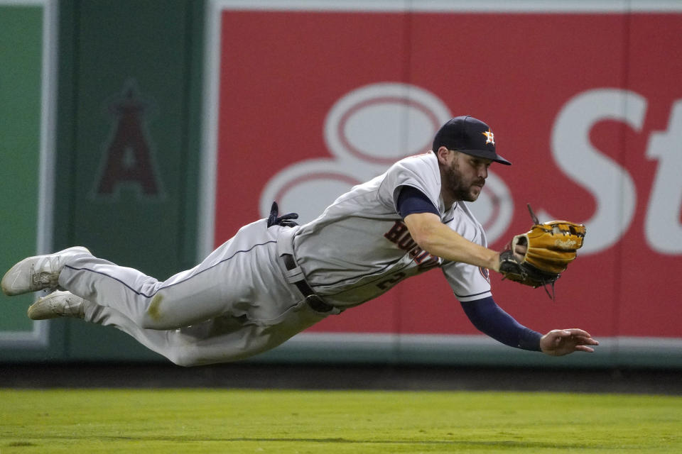 Houston Astros right fielder Chas McCormick makes a catch on a ball hit by Los Angeles Angels' Phil Gosselin during the seventh inning of a baseball game Wednesday, Sept. 22, 2021, in Anaheim, Calif. (AP Photo/Mark J. Terrill)