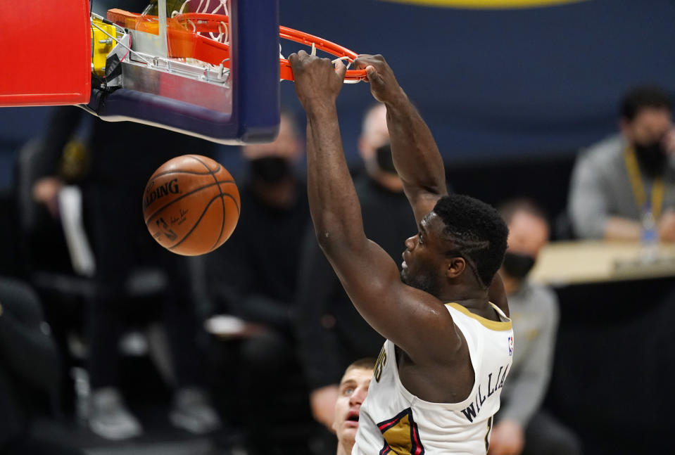 New Orleans Pelicans forward Zion Williamson dunks the ball for a basket in the second half of an NBA basketball game against the Denver Nuggets Sunday, March 21, 2021, in Denver. The Pelicans won 113-108. (AP Photo/David Zalubowski)
