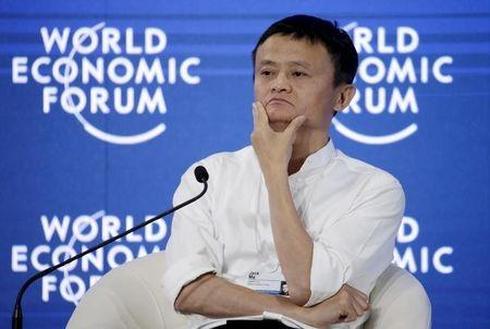 """Chairman and chief executive of Alibaba Group Jack Ma reacts during a session of """"Future-Proofing the Internet Economy"""" at the World Economic Forum (WEF) in China's port city Dalian, September 9, 2015.  REUTERS/Jason Lee"""