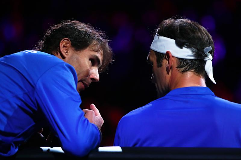 GENEVA, SWITZERLAND - SEPTEMBER 21: Rafael Nadal of Team Europe speaks to teammate Roger Federer as he sits down during his singles match against Nick Kyrgios of Team World during Day Two of the Laver Cup 2019 at Palexpo on September 21, 2019 in Geneva, Switzerland. The Laver Cup will see six players from the rest of the World competing against their counterparts from Europe. Team World is captained by John McEnroe and Team Europe is captained by Bjorn Borg. The tournament runs from September 20-22. (Photo by Clive Brunskill/Getty Images for Laver Cup)