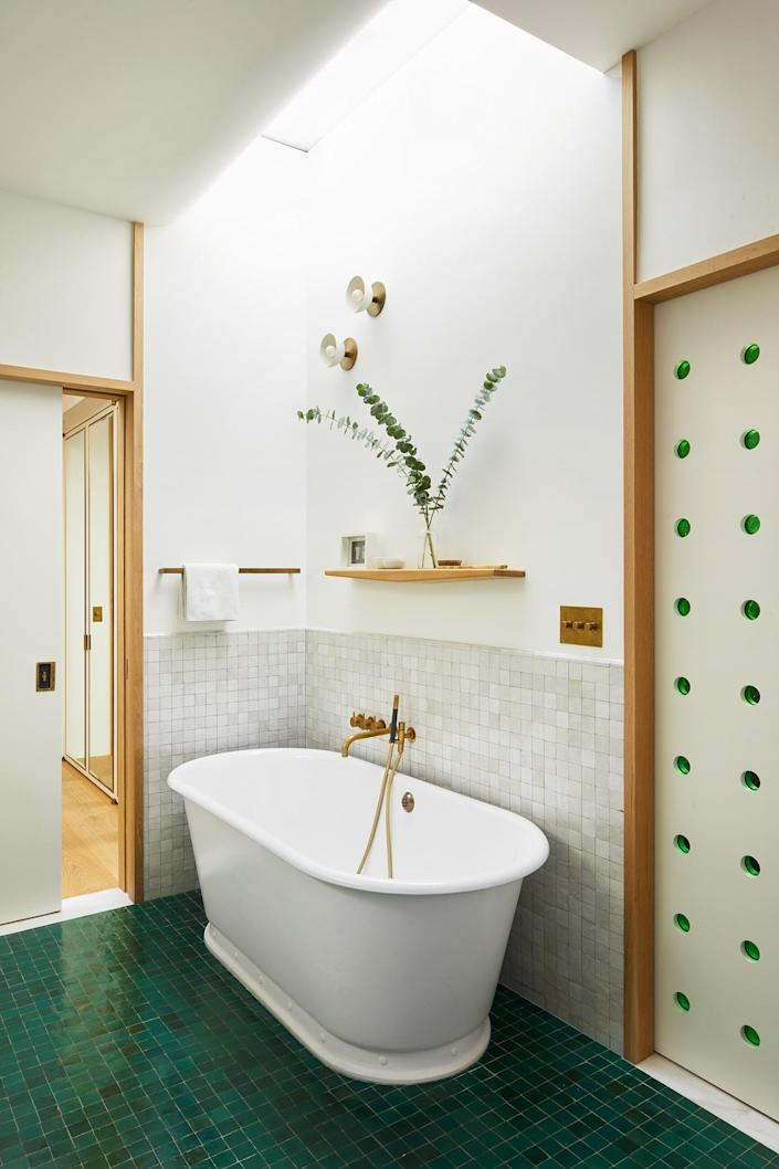 In the bathroom, which is situated on the third floor, the tub is from Waterworks.