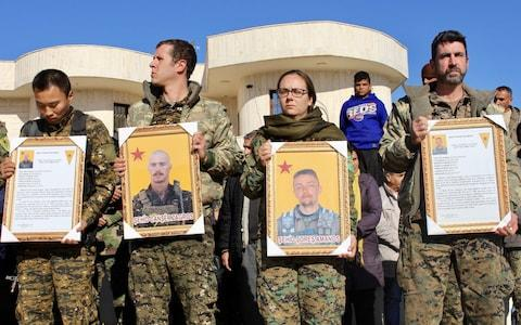 A military ceremony held in Syria for two Britons: Jac Holmes, from Bournemouth and Oliver Hall from Hampshire, killed while fighting with the Kurdish YPG militia - Credit: Facebook
