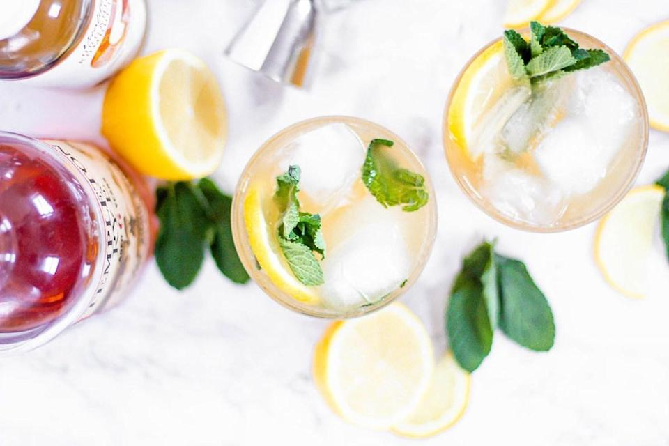 """<p>This Kombucha Whiskey Ginger Smash recipe adds a bit of lemon juice and some mint leaves to ginger kombucha. Leave out the shot of whiskey, and you'll have yourself a virgin variety of the drink.</p> <p><a href=""""https://www.thedailymeal.com/recipes/kombucha-whiskey-ginger-smash-recipe?referrer=yahoo&category=beauty_food&include_utm=1&utm_medium=referral&utm_source=yahoo&utm_campaign=feed"""" rel=""""nofollow noopener"""" target=""""_blank"""" data-ylk=""""slk:For the Kombucha Ginger Smash recipe, click here."""" class=""""link rapid-noclick-resp"""">For the Kombucha Ginger Smash recipe, click here.</a></p>"""