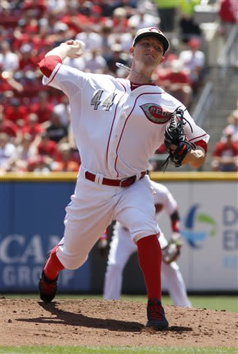 Cincinnati Reds starting pitcher Mike Leake throws against the Cleveland Indians in the first inning during a baseball game, Monday, May 27, 2013, in Cincinnati. (AP Photo/David Kohl)