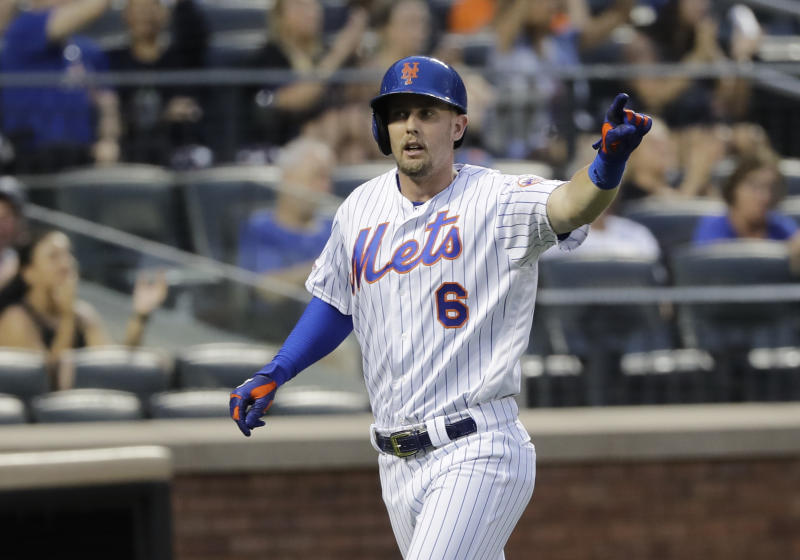 New York Mets' Jeff McNeil gestures to Robinson Cano after scoring on a single by Cano during the sixth inning of the team's baseball game against the Atlanta Braves on Saturday, June 29, 2019, in New York. (AP Photo/Frank Franklin II)