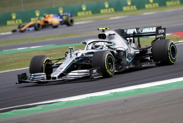 Mercedes driver Valtteri Bottas of Finland steers his car during the second free practice at the Silverstone racetrack, in Silverstone, England, Friday, July 12, 2019. The British Formula One Grand Prix will be held on Sunday. (AP Photo/Luca Bruno)